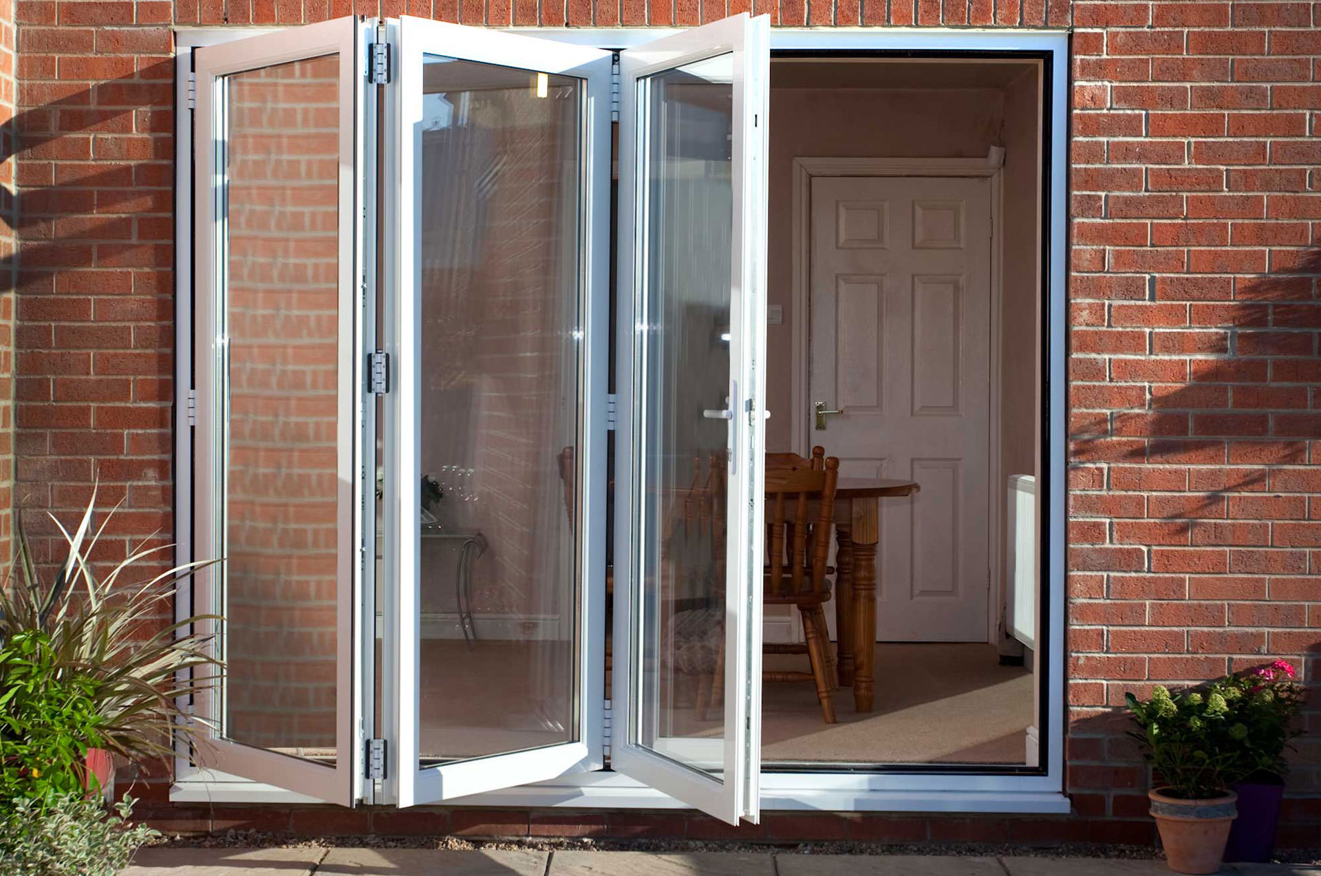 Bi fold doors epsom surrey bi folding doors coulsdon for Upvc folding doors